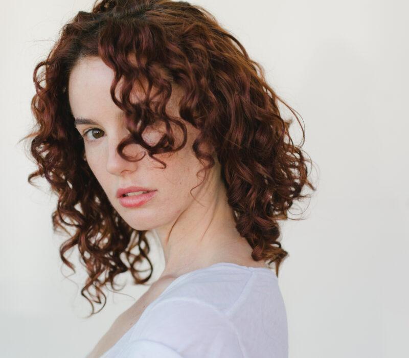 showcasing a woman's natural curly hair