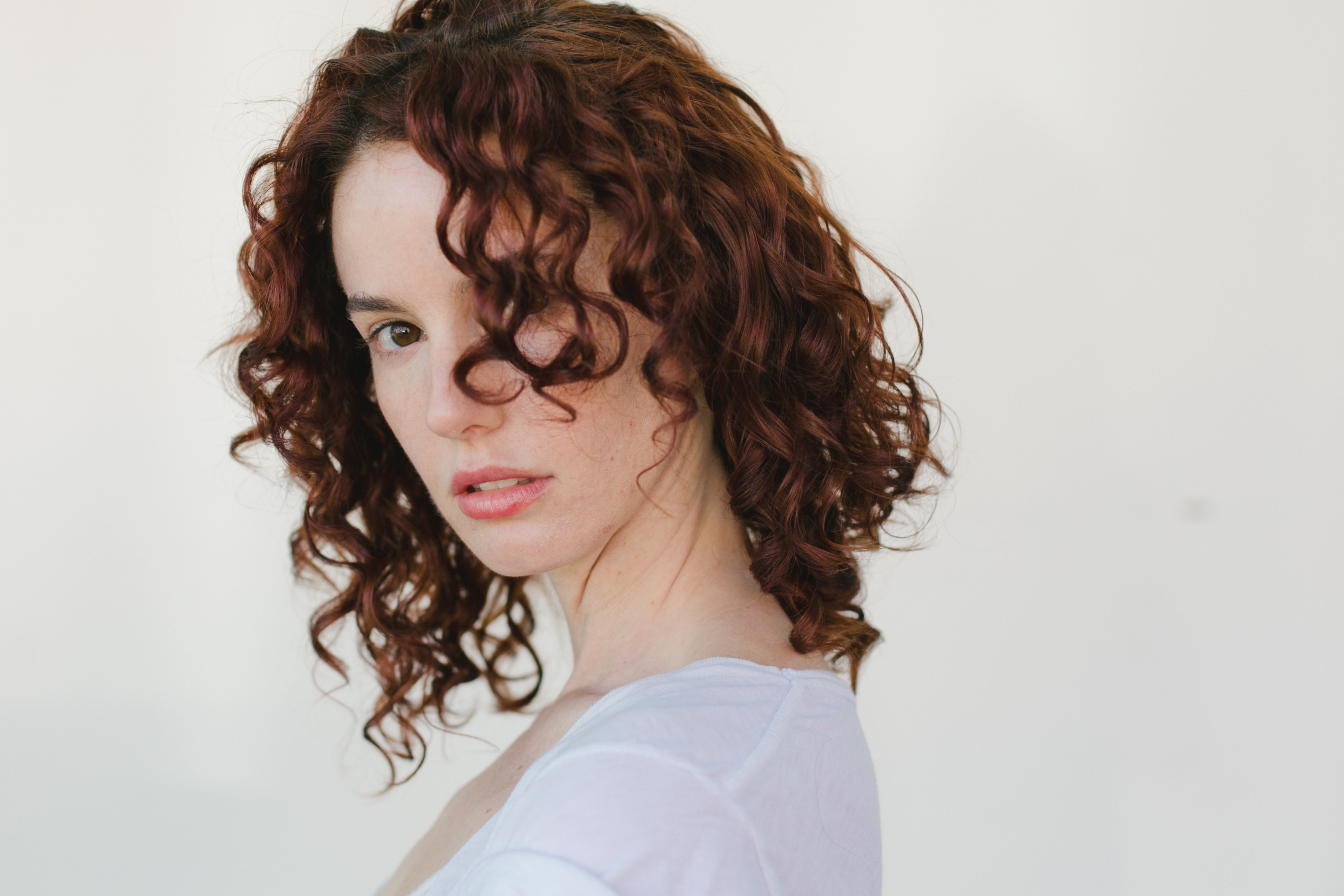 showcasing a woman's natural curly hair